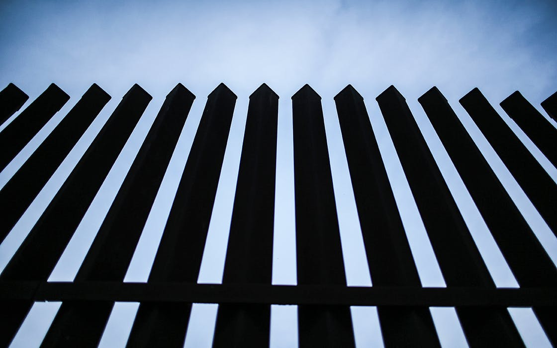 The U.S.-Mexico border fence stands on December 8, 2015 near McAllen.