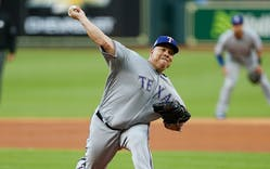 Bartolo Colon #40 of the Texas Rangers pitches in the first inning against the Houston Astros at Minute Maid Park on April 15, 2018 in Houston.