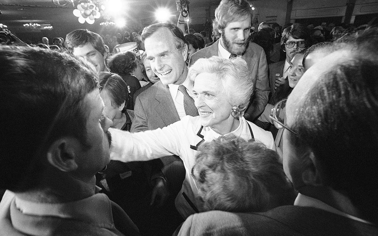 George and Barbara Bush smile and shake hands with supporters after he spoke in Concord during the Republican presidential primary on Tuesday, Feb. 26, 1980.
