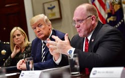 President Donald Trump (C) at the White House on March 20, 2018 in Washington, D.C., joined by Homeland Security Secretary Kirstjen Nielsen (L) and Thomas Homan, acting director of Immigration and Customs Enforcement.