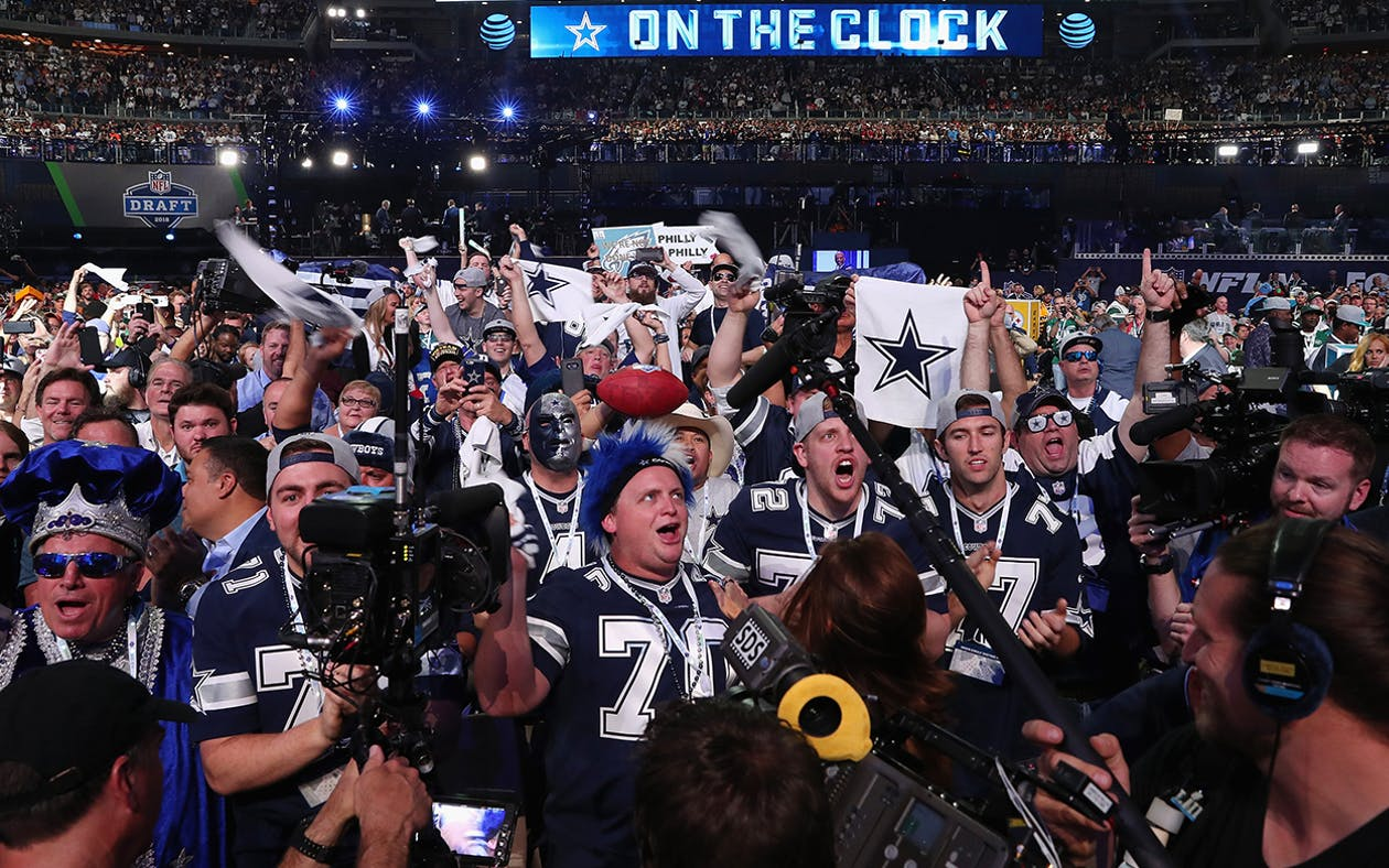 Dallas Cowboys fans cheer during the first round of the 2018 NFL Draft at AT&T Stadium on April 26, 2018 in Arlington.