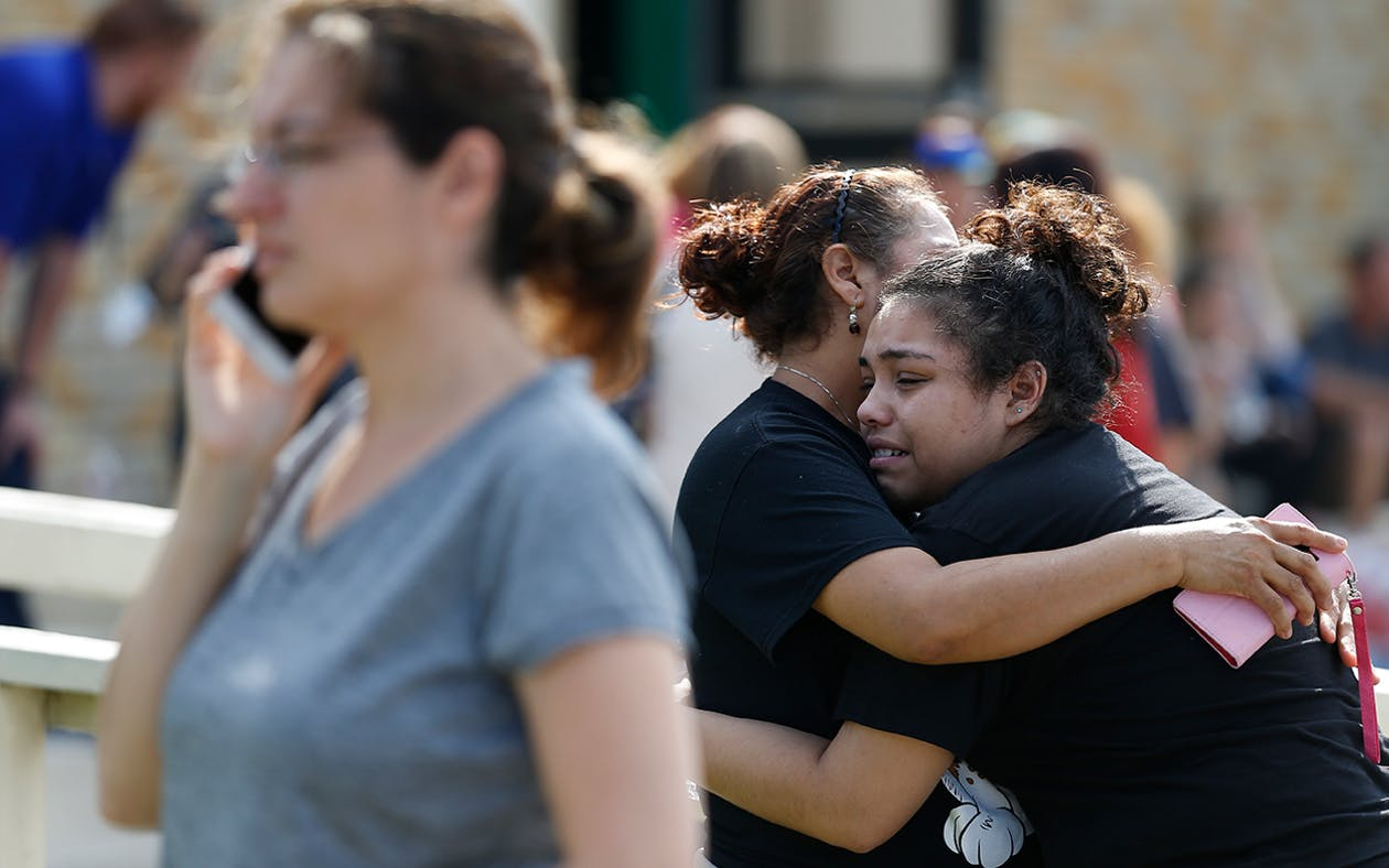Santa Fe High School junior Guadalupe Sanchez, 16, cries in the arms of her mother, Elida Sanchez, after reuniting with her at a meeting point at a nearby Alamo Gym fitness center following a shooting at Santa Fe High School in Santa Fe, Texas, on Friday, May 18, 2018.