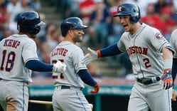 Alex Bregman #2 of the Houston Astros celebrates with Jose Altuve #27 and Tony Kemp #18 after hitting a three run home run off Mike Clevinger #52 of the Cleveland Indians during the fifth inning at Progressive Field on May 24, 2018 in Cleveland, Ohio.