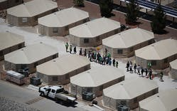 Children and workers are seen at a tent encampment recently built near the Tornillo Port of Entry on June 19, 2018 in Tornillo, Texas.