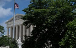 The U.S. Supreme Court is seen behind trees after it ruled that states may collect sales tax from retailers that do not have a physical presence, on June 21, 2018 in Washington, DC.