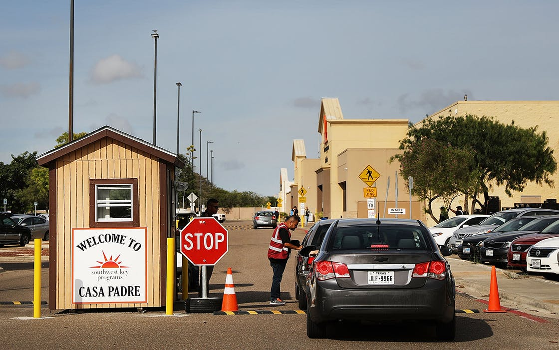 A security guard checks cars at the entrance to Casa Padre, a former Walmart which is now a center for unaccompanied immigrant children on June 24, 2018 in Brownsville, Texas.