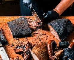 Pitmaster and co-owner Matt Lowery of LJ's BBQ in Brenham prepares a smoked brisket taco.