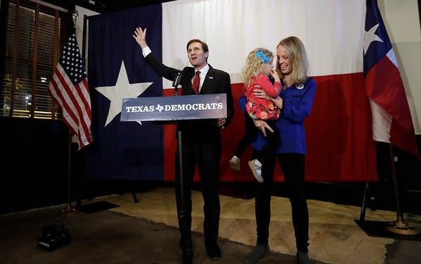 Democratic Texas Attorney General candidate Justin Nelson, left, with his wife Elizabeth and daughter Adeline talks to supporters during a Democratic watch party following the Texas primary election, Tuesday, March 6, 2018, in Austin.