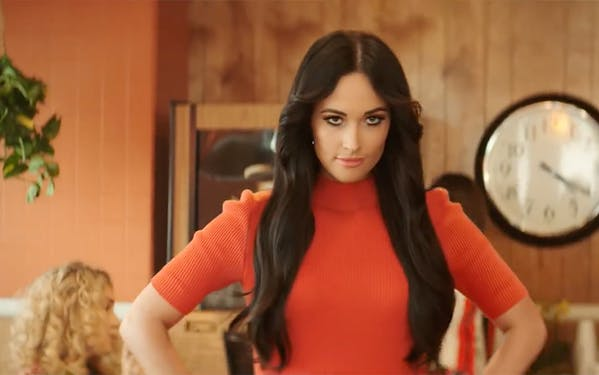 "Kacey Musgraves in her new music video for ""High Horse."""
