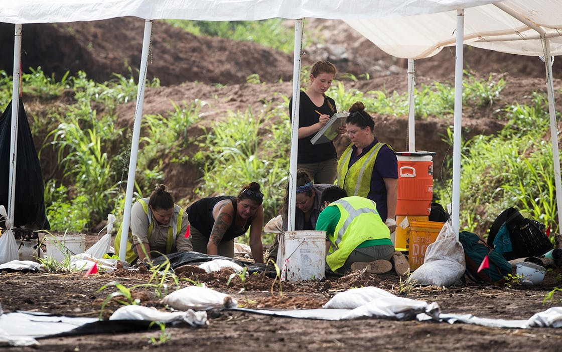 Students hand excavate at a historic burial site, July 16, 2018, at the site of the James Reese Career and Technical Center in Sugar Land where a historic cemetery was discovered earlier this year.