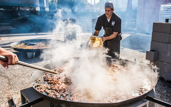 Chef Ryan Pera of the HOUBBQ Collective cooks paella at the Southern Smoke festival in 2017.