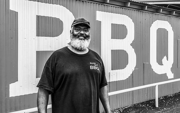 Pitmaster Johnny Walker in front of Momma Jean's BBQ in Lampasas.