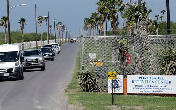 Vehicles leave the Port Isabel Detention Center, which holds detainees of the U.S. Immigration and Customs Enforcement, Tuesday, June 26, 2018, in Los Fresnos, Texas.