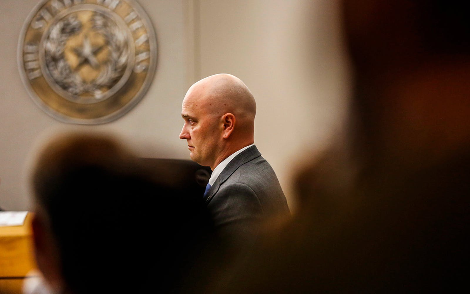 Defendant Roy Oliver stands during the defense's closing argument during the eighth day of his trial in Dallas on August 27, 2018.