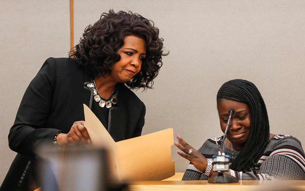 Charmaine Edwards reacts to an autopsy photo of her son Jordan Edwards shown by District Attorney Faith Johnson during a testimony on the first day of the trial in Dallas on Thursday, Aug. 16, 2018.