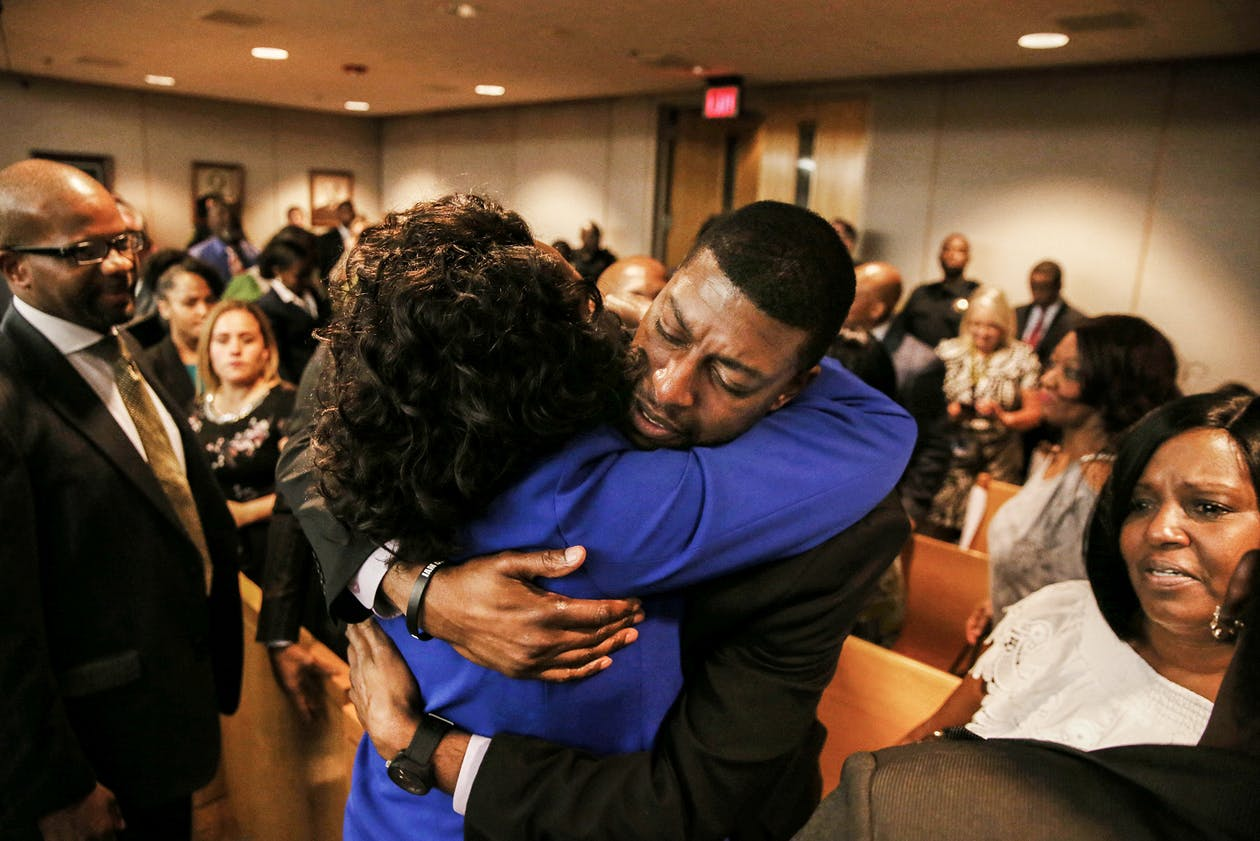 Odell Edwards, father of Jordan Edwards, gets a hug from Dallas County district attorney Faith Johnson after hearing a guilty of murder verdict during the ninth day of the trial of fired Balch Springs police officer Roy Oliver, who was charged with the murder of 15-year-old Jordan Edwards, in Dallas on Tuesday, Aug. 28, 2018.