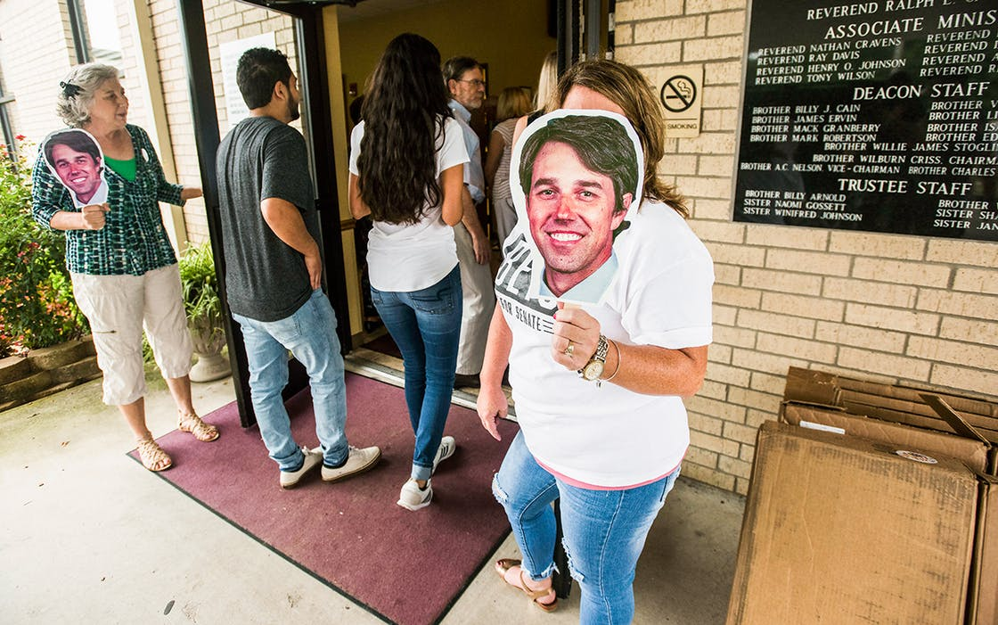 Campaign volunteers Geralyn Johnson of Bullard, left, and Rose Assad of Flint, right, hold paper cut-outs of the face of Beto O'Rourke, D-El Paso, at the doors of St. Louis Baptist Church in Tyler, where O'Rourke made a campaign stop to speak with voters on Monday Aug. 13, 2018.