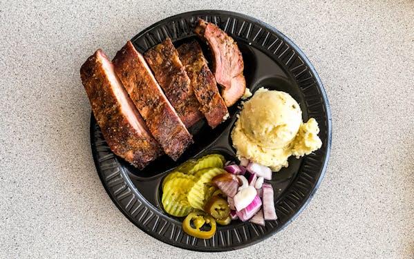 Lemon pepper ribs (left) alongside the seasoned ribs at Off the Bone BBQ