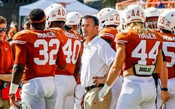 Texas defensive coordinator Todd Orlando briefs his players during the first half of an NCAA college football game against Oklahoma State, Saturday, Oct. 21, 2017, in Austin.