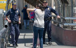 Customs and Border Protection agents question people at the International bridge Tuesday, June 19, 2018 in El Paso.