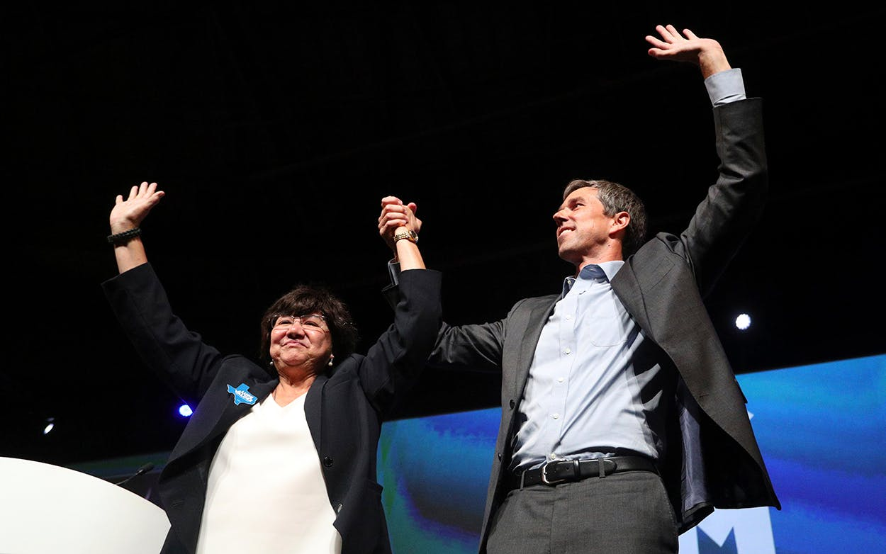 Lupe Valdez and Beto O'Rourke raise their hands as they are cheered at the end of the general session at the Texas Democratic Convention Friday, June 22, 2018, in Fort Worth.