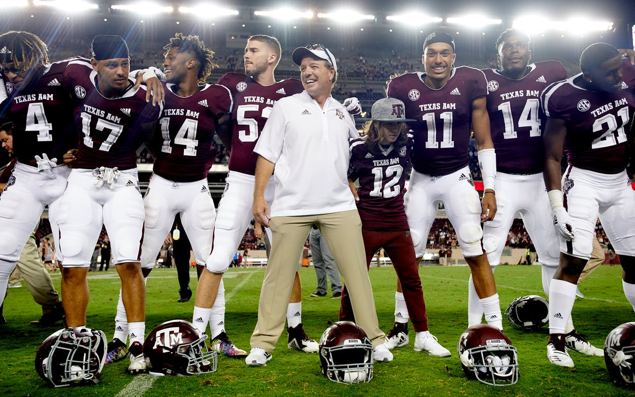 Texas A&M Aggies head coach Jimbo Fisher celebrates with his team after defeating the Northwestern State Demons in a football game at Kyle Field on August 30, 2018 in College Station.
