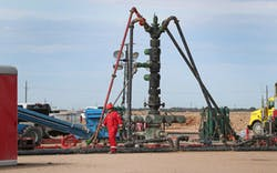 In a Monday, June 26, 2017 photo, a Halliburton wellhead is visible at a fracking site in Midland.
