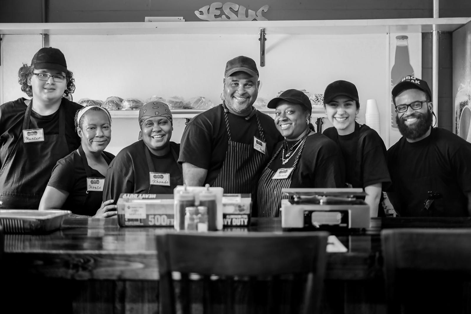 Owner and pitmaster Abraham Franks (center) with his wife Tonia (center right), daughter Rhonda (center left) and the rest of the Franks Holy Smoke BBQ team.