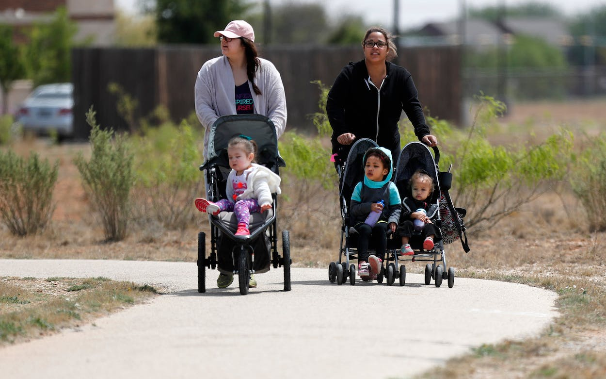Two women push strollers in Odessa, a city where many millennials are moving.