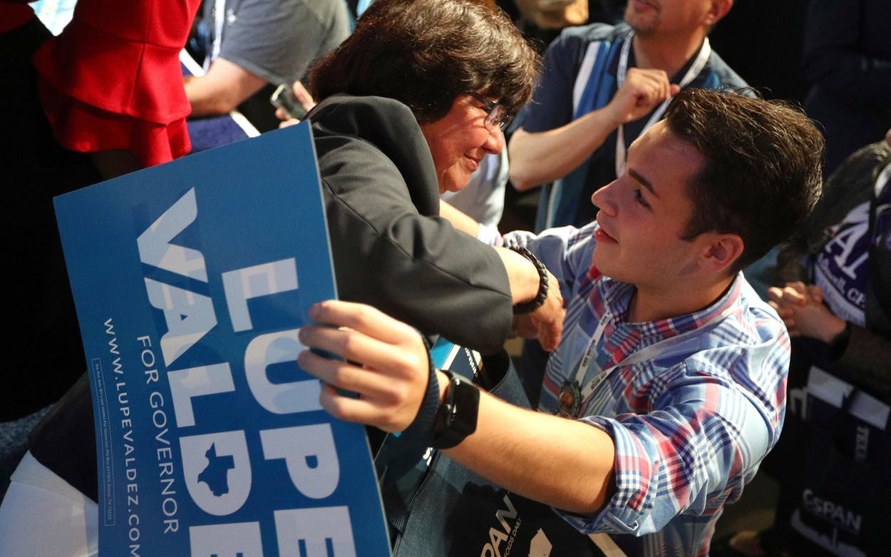 Texas gubernatorial candidate Lupe Valdez gets a hug from Zachary DeNobrega of Sugarland after the general session at the Texas Democratic Convention Friday, June 22, 2018, in Fort Worth.