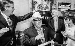 Republican Pete Flores, second from left, talks to supporters as Texas Lt. Gov. Dan Patrick, left, and Republican State Chairman James Dickey, second from right, high-five after Flores defeated Democrat Pete Gallego in a runoff election Sept. 18, 2018, in San Antonio.