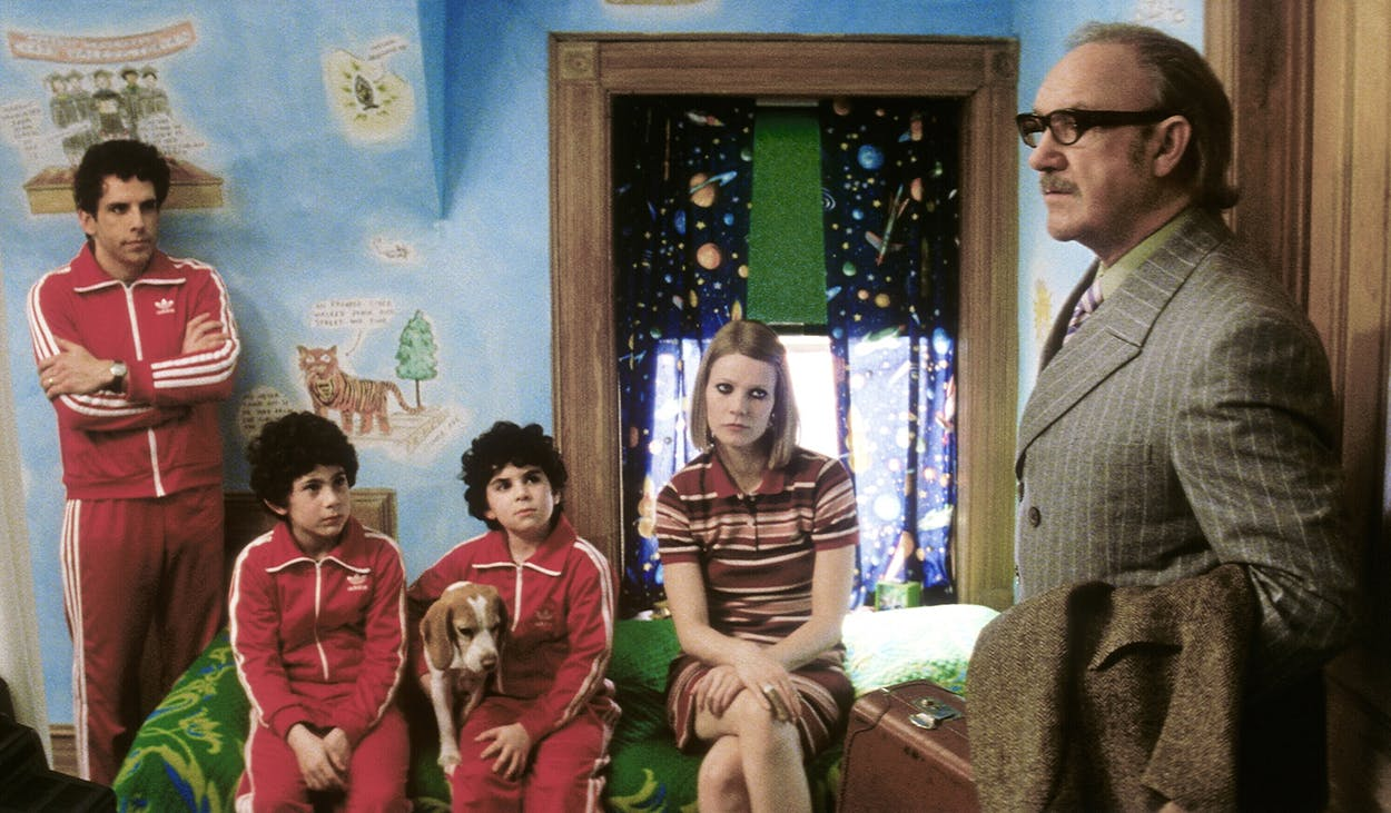 "Ben Stiller (as Chas Tenenbaum), Gwyneth Paltrow (as Margot Tenenbaum), and Gene Hackman (as Royal Tenenbaum) in the 2001 Wes Anderson film ""The Royal Tenenbaums."""