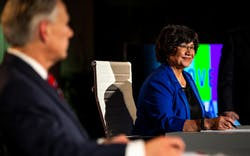 Democratic candidate for governor Lupe Valdez, right, smiles before a debate against Gov. Greg Abbot, left, at the LBJ Library in Austin on Friday, Sept. 28, 2018.