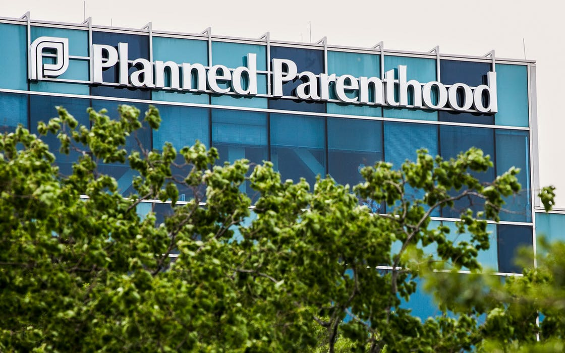 A logo sign outside of a facility occupied by Planned Parenthood in Houston on May 28, 2017. Planned Parenthood of Greater Texas will announce this week that it will open a facility in El Paso.