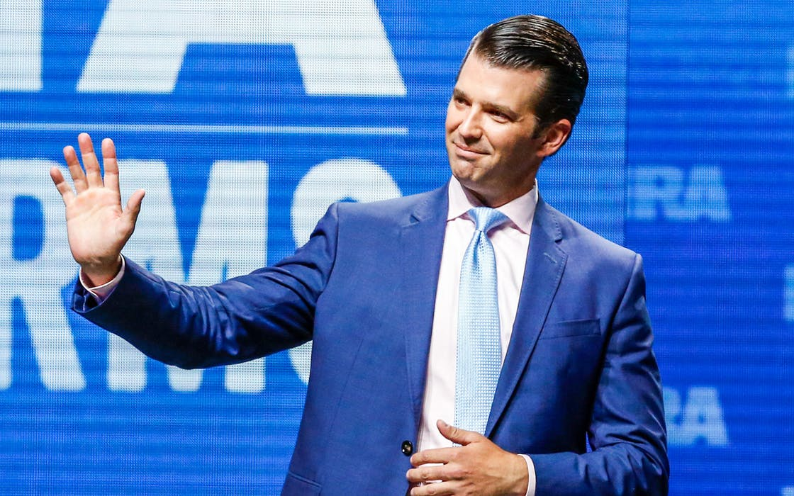 In this May 4, 2018, file photo, Donald Trump Jr. waves from the stage at the National Rifle Association in Dallas.