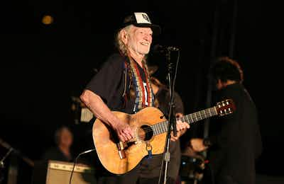 """Artist Willie Nelson performs during the """"Turn Out for Texas"""" concert and rally for Senate candidate Beto O'Rourke (D-TX) on Saturday, Sept. 29, 2018 in Austin."""