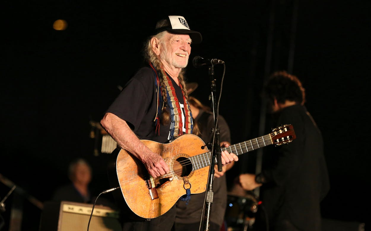 Artist Willie Nelson performs during the