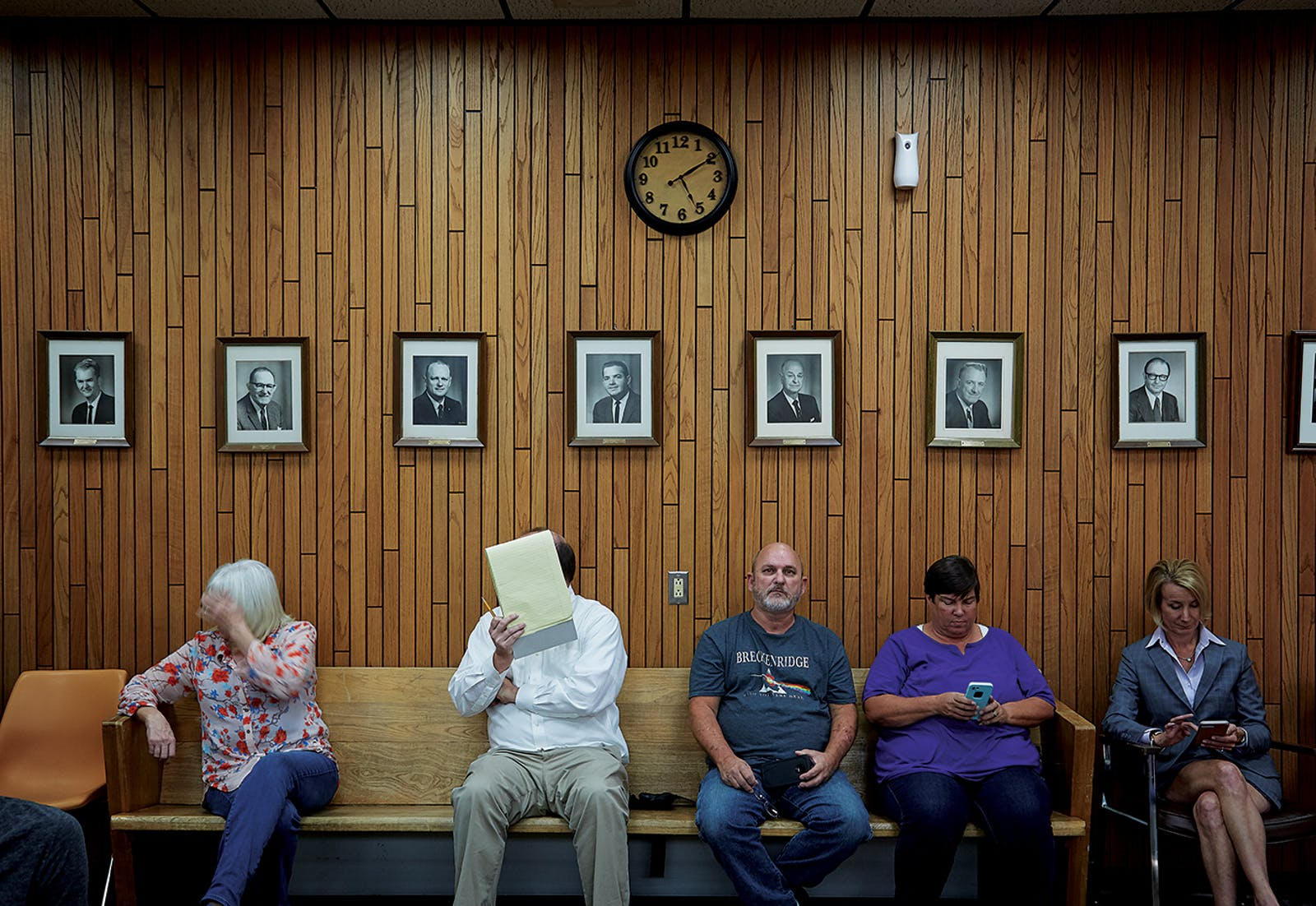 people waiting at the Groves city council meeting