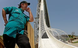 Ride designer Jeff Henry looks over his creation, the world's tallest waterslide called
