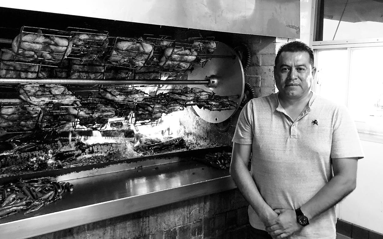 Jose Vega in front of the rotisserie at the Arlington location of Pollos la Pullita