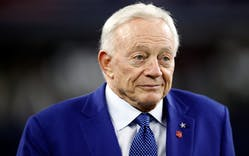 Owner Jerry Jones of the Dallas Cowboys walks on the field before a game on November 30, 2017 in Arlington.