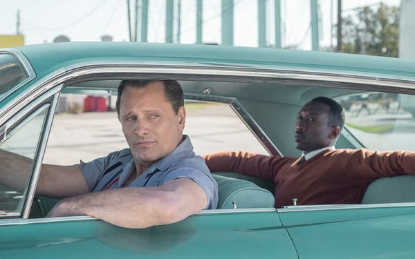 "Frank Anthony (""Tony Lip"") Vallelonga (played by Viggo Mortensen) and Donald Shirley (played by Mahershala Ali) in Green Book."