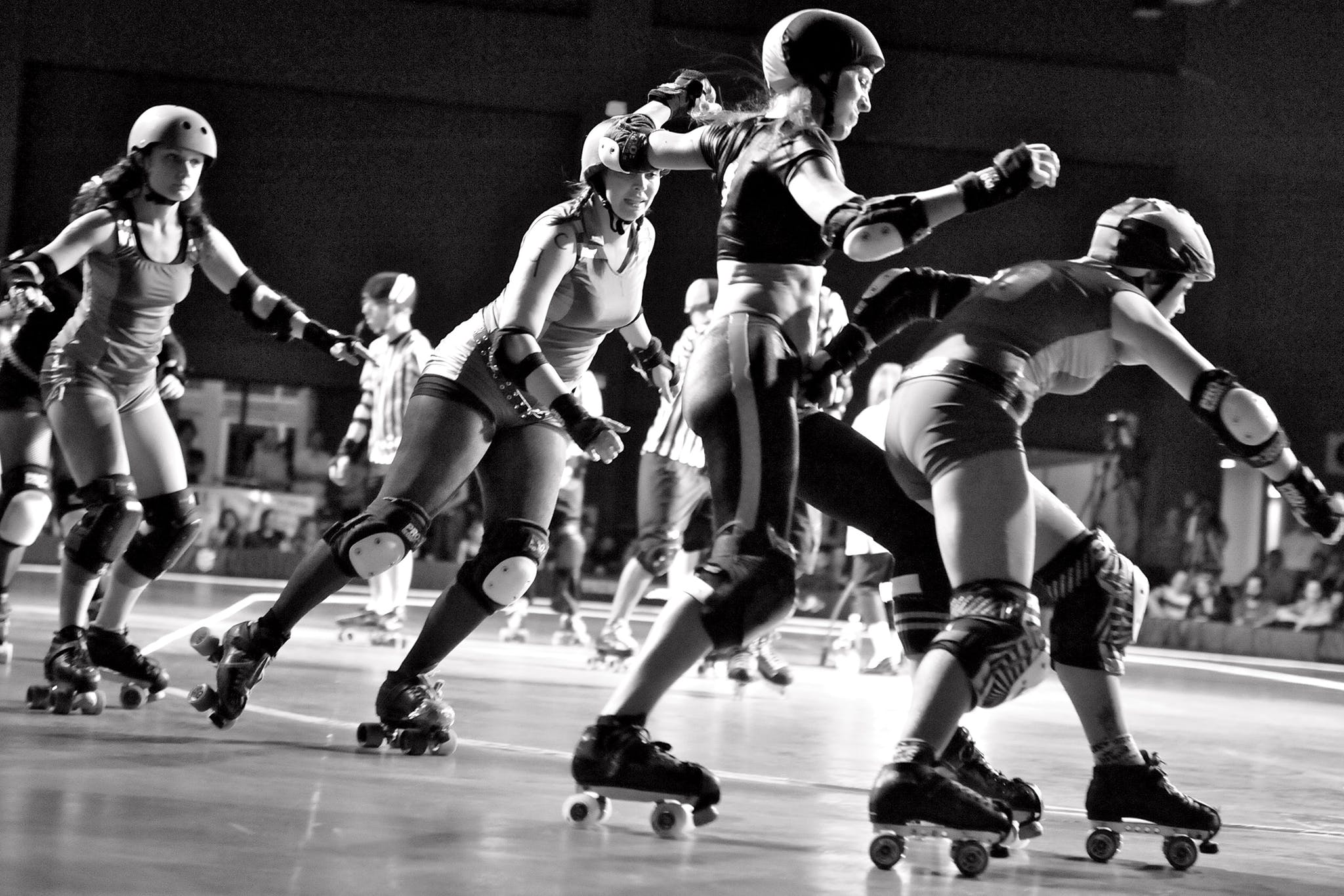 Players Chasing Amy, Babe Ruthless, Voodoo Doll, and Molotov M. Pale during a roller derby bout