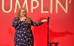 Danielle Macdonald speaks onstage at a luncheon for the Netflix Film Dumplin' on October 22, 2018 in Los Angeles, California.