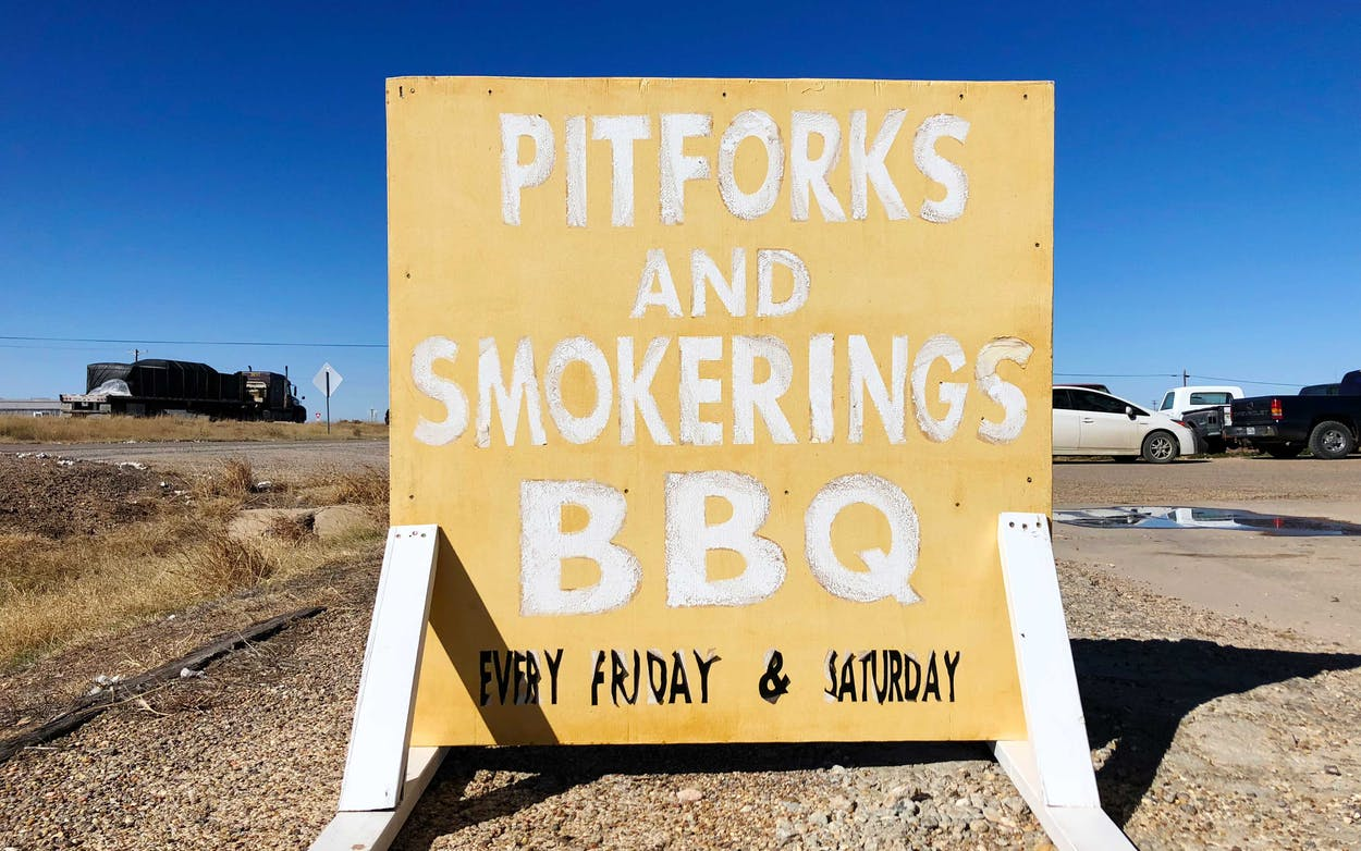 The sign for Pitforks and Smokerings BBQ along Highway 84