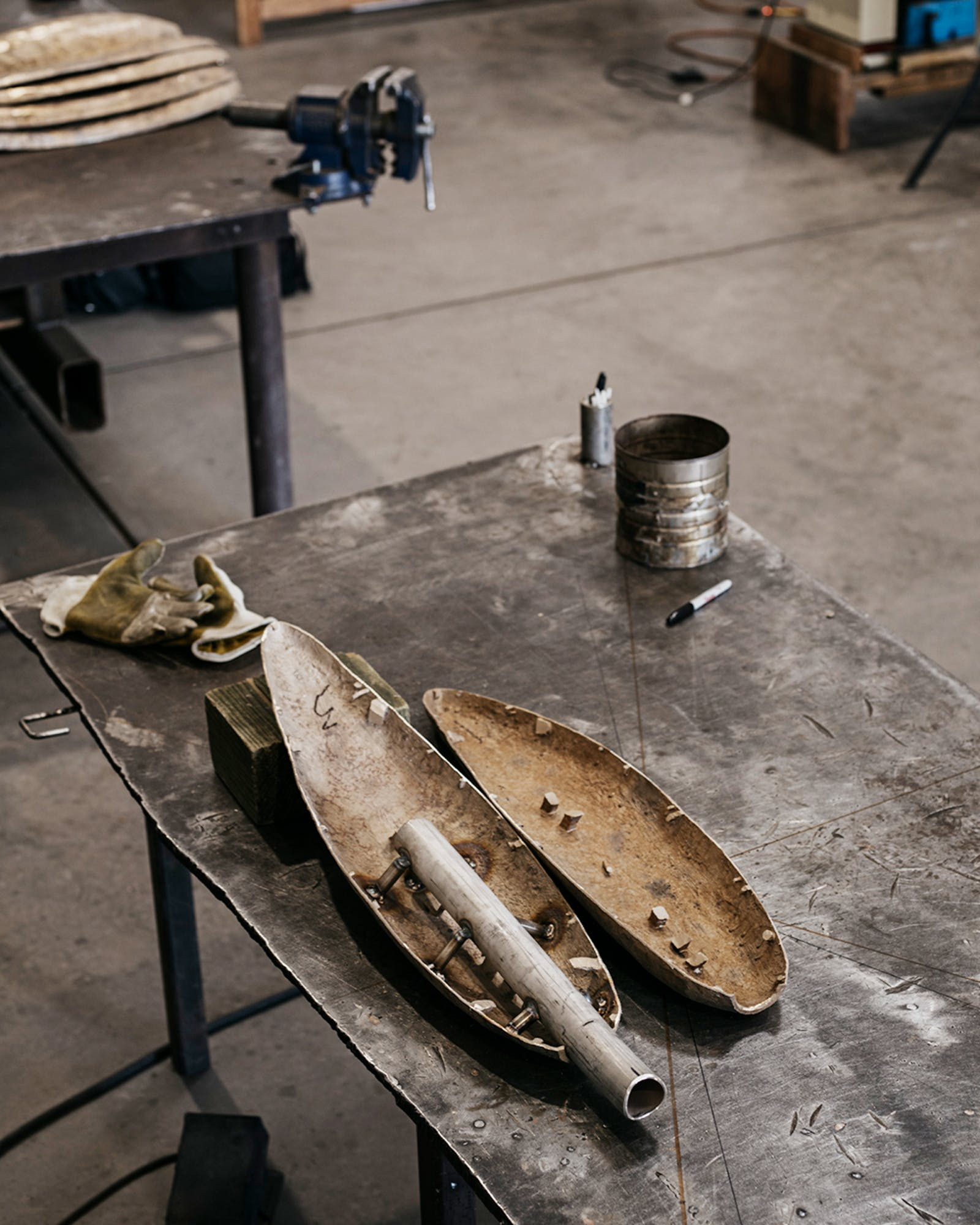 "A leaf on a sculpture titled ""This Place, Everywhere"", which was commissioned for The Dallas Holocaust Museum/Center for Education and Tolerance, waits to be welded."