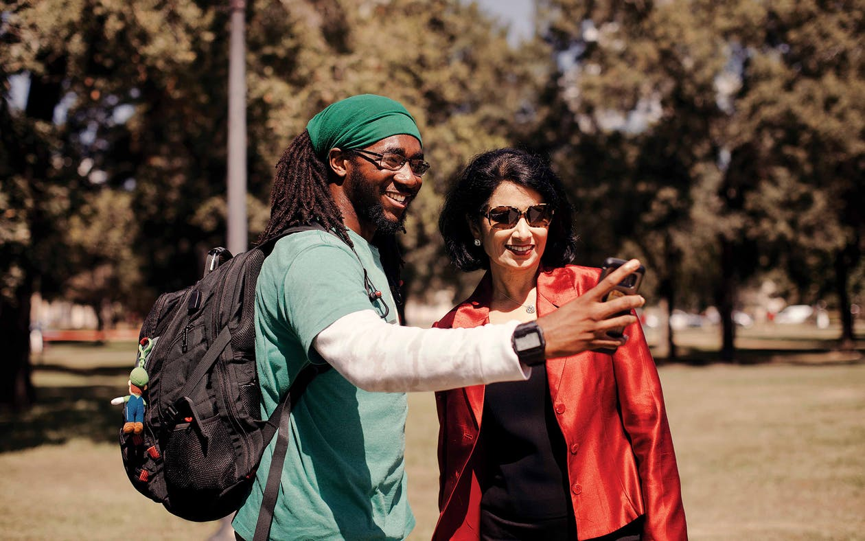 Khator stops for a selfie with a student while walking across the UH campus.