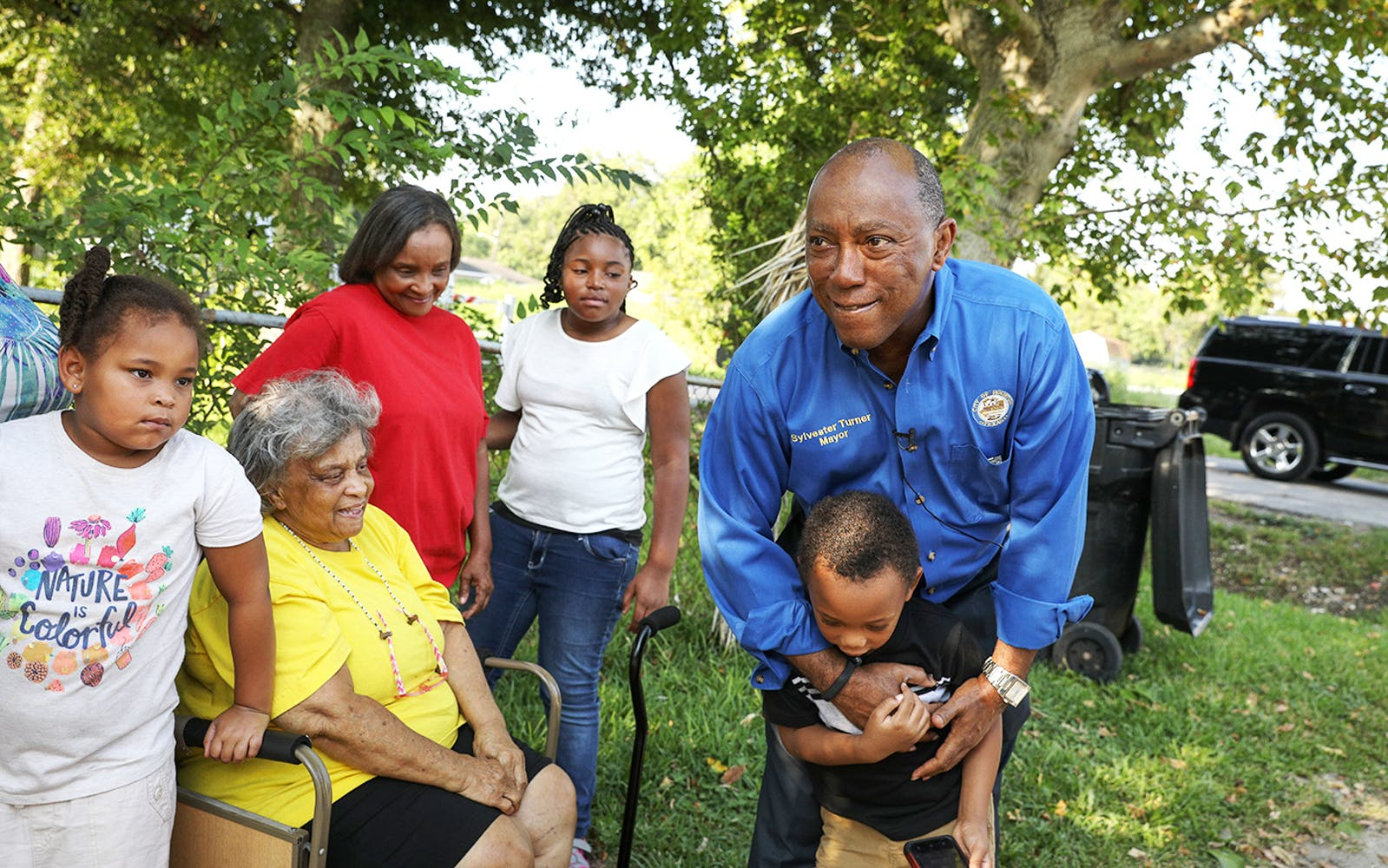 Mayor Turner hugs five-year-old Kamarion Henderson in the Kashmere Gardens neighborhood on August 25, 2018 in Houston. August 25 was the one-year anniversary of when Hurricane Harvey made landfall on the Texas coast, before inflicting severe damage on the Kashmere Gardens neighborhood and the city of Houston.
