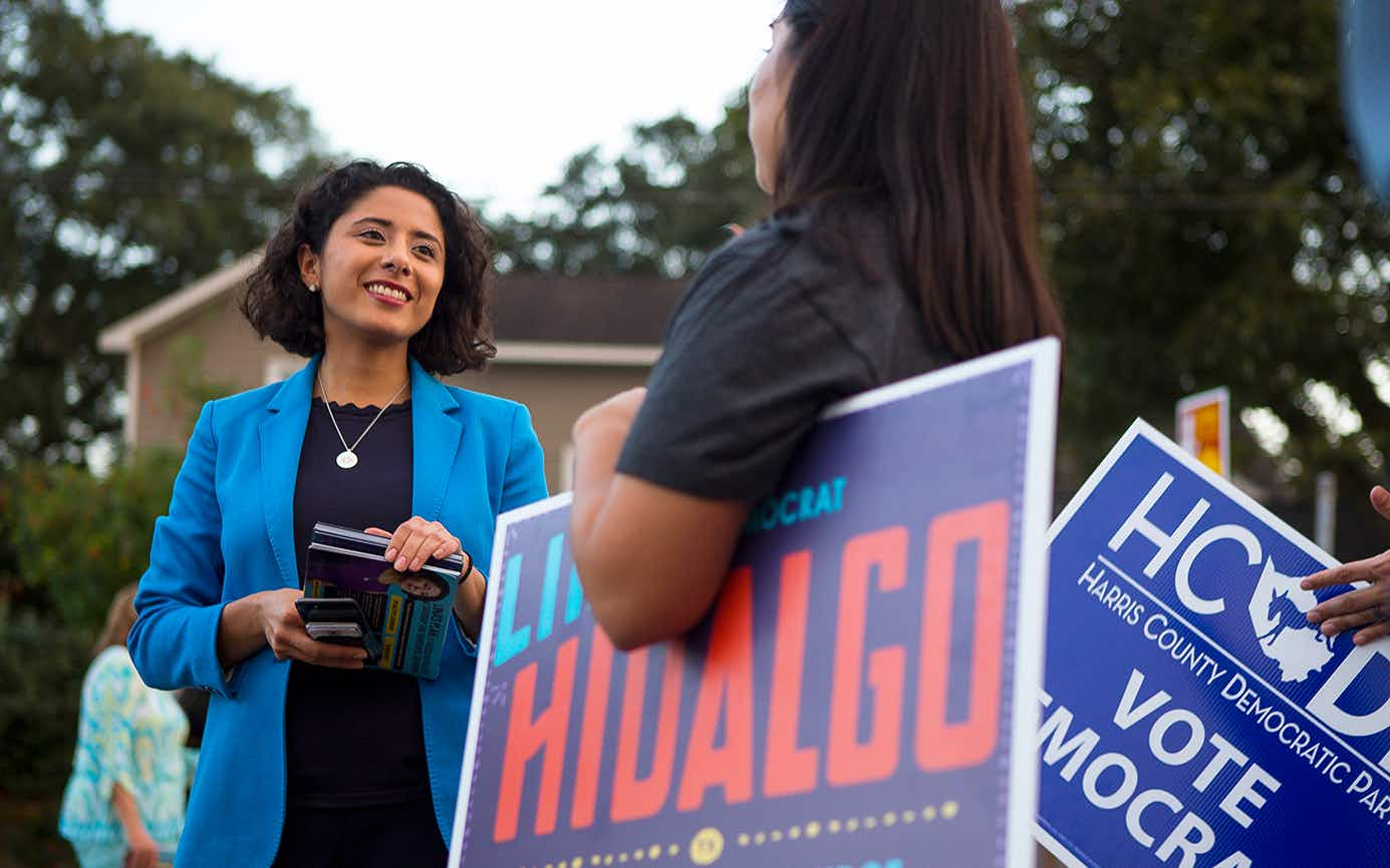 Democrat candidate for Harris County Judge, Lina Hidalgo, talks with campaign volunteers outside of a polling place located at the SPJST Lodge 88 in the Heights, Tuesday, Nov. 6, 2018 in Houston.