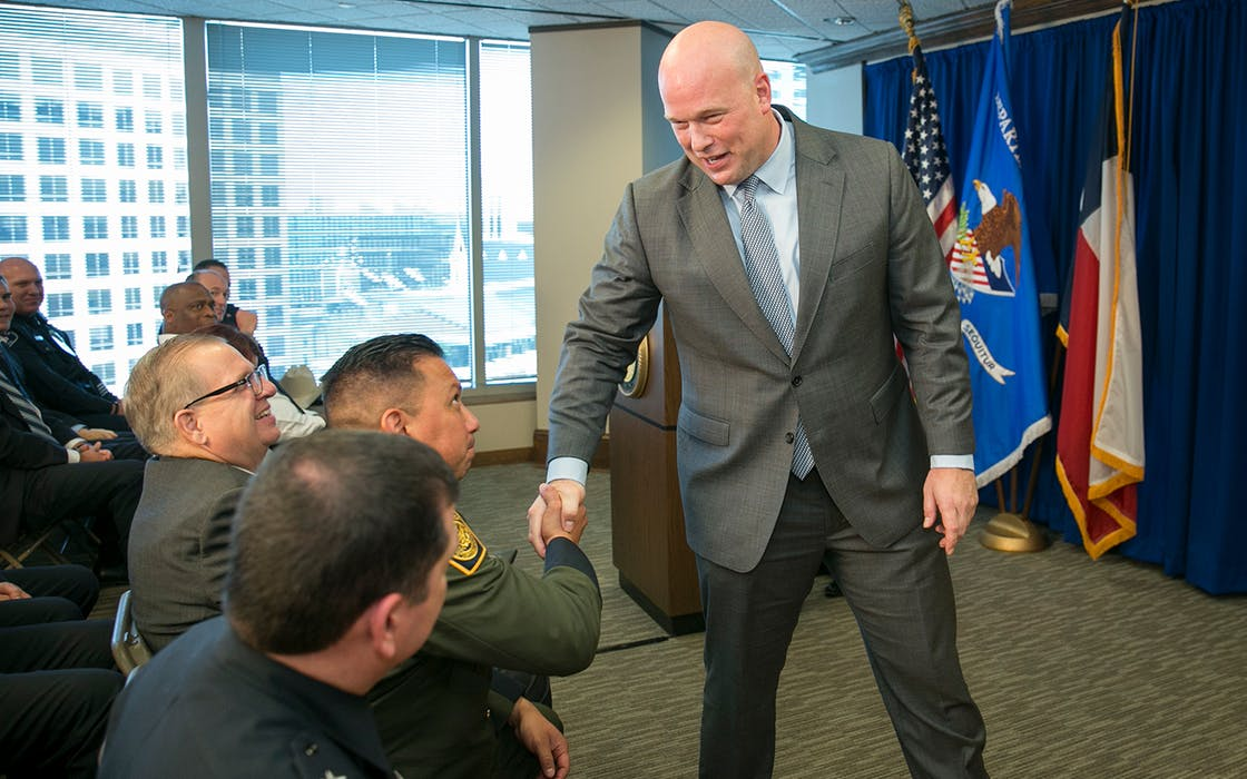 Acting U.S. Attorney General Matthew G. Whitaker shakes hands after speaking to area law enforcement officials at the U.S. Attorney's Office for the Western District of Texas in Austin, Tuesday, Dec. 11, 2018.